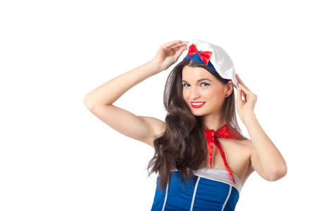 Portrait of a sexy sailor woman holding her beret. High resolution image taken in studio, isolated on white with copy space for your ad.  Stock Photo