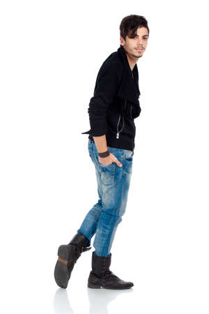 thin man: Handsome young fashion model wearing jeans, boots and a black jacket. Isolated on white background. Studio vertical image. Stock Photo