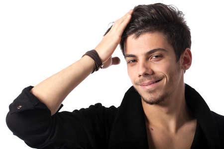 homosexuales: Retrato de un joven feliz con peinado fresco mirando a la c�mara. Aislado sobre fondo blanco. Estudio horizontal de la imagen. Foto de archivo