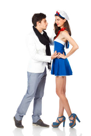 Elegant young man seducing a beautiful attractive woman dressed in sailor uniform. Isolated on white background. High resolution studio image Stock Photo - 12388960
