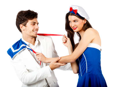 Joyful young couple enjoy roleplay in sailor uniform and elegant suit. Isolated on white background. High resolution studio image Stock Photo - 12388975