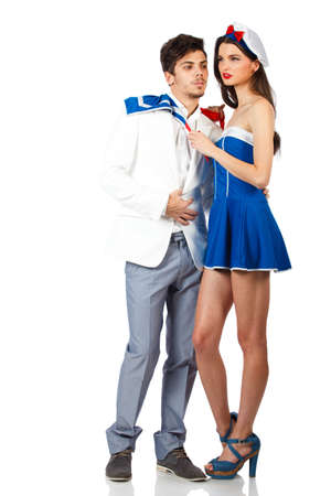 Young sexy couple enjoy roleplay in sailor uniform. Full body shot. Isolated on white background. High resolution studio image Stock Photo - 12388961