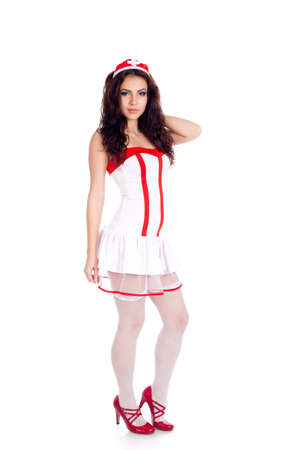 Sexy young nurse with long curly hair on isolated white background. High resolution studio image with copy space for text. photo