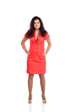 Beautiful professional young nurse or medical woman doctor with big breasts, wearing tangerine tango orange uniform dress , holding hands on hips.  Full body isolated  on white background with text space. High resolution studio image. Stock Photo - 12631765