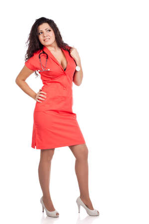 Attractive happy young nurse or medical woman doctor with big breasts, wearing tangerine tango orange uniform dress , smiling, posing, looking aside. Full body isolated on white background with text space. High resolution studio image. Stock Photo - 12631766