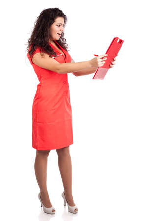 Beautiful professional young nurse or medical woman  doctor with big breasts, wearing tangerine tango orange uniform dress ,with clipboard  happy about results.  Full body isolated on white background with text space. High resolution studio image. Stock Photo - 12631774