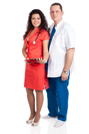 body image: Young smiling couple of handsome man doctor and pretty nurse in blue, white and tangerine tango uniforms, looking at camera. Full body image, isolated on white background. Healthcare concept series. Stock Photo