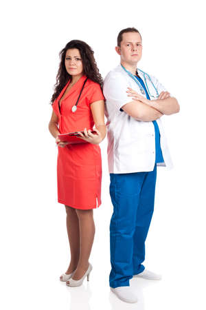 Professional couple of handsome man doctor and pretty nurse in blue, white and tangerine tango uniforms, looking at camera. Full body image, isolated on white background. Healthcare concept series. photo