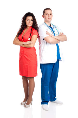 Young professional couple of handsome man doctor and pretty nurse in blue, white and tangerine tango uniforms, looking at camera. Full body image, isolated on white background. Healthcare concept series. photo