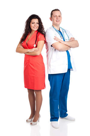 Young smiling couple of handsome man doctor and pretty nurse in blue, white and tangerine tango uniforms, looking at camera. Full body image, isolated on white background. Healthcare concept series. photo