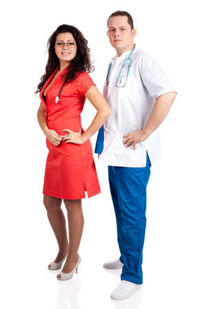 Beautiful nurse dressed in tangerine tango uniform and handsome doctor dressed in blue and white scrubs. Full body image isolated on white background. Healthcare concept series. photo