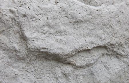 textura: sfondo di un rilievo in pietra bianca con irregolarità Archivio Fotografico