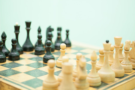 old styled: Old styled chess board with figures Stock Photo