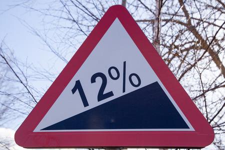 steep: Road sign steep climb on wood background