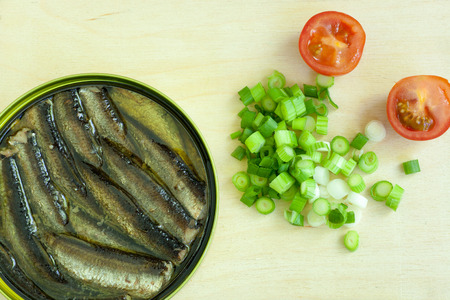 sardine can: sprats on a wooden table