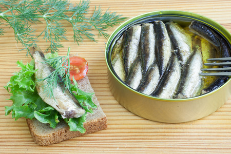 vegetable tin: sprats and tomatoes on a table
