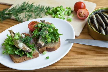vegetable tin: sprats a table