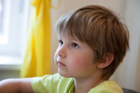 a little boy who looks and listens attentively
