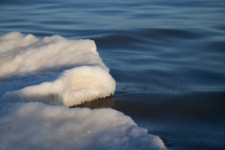 floe: Part of the ice floe in the sea under the sun Stock Photo