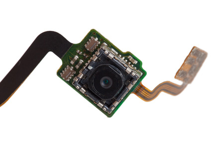 close circuit camera: Close-up mobile camera on electronic board isolated on white