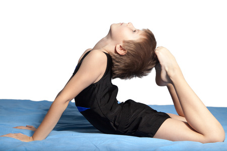 The boy does gymnastics