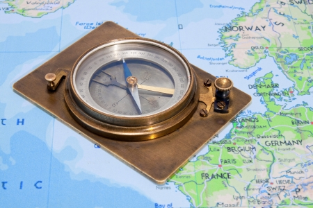 Compass lying on a map photo