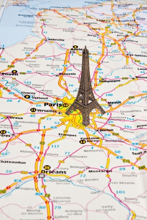 Small copy of Eiffel tower in Paris on map  Stock Photo - 16979872