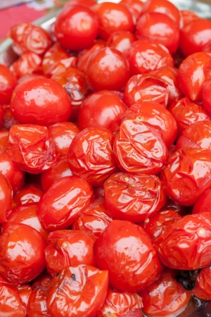 seizing: Pickled red tomatoes close-up