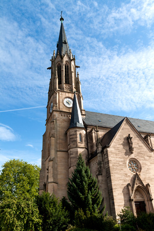 Protestant church with a clock on the tower in Bad Kissengen in Germany photo