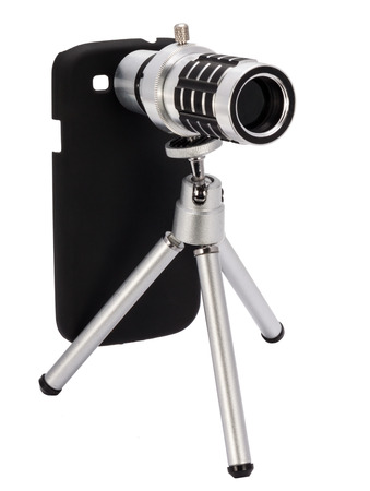 telescopic lens attachment for a smartphone isolated on white background photo