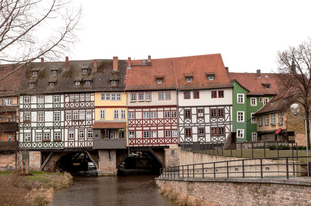 passing over: Street passing over the bridge with houses, Erfurt, Germany