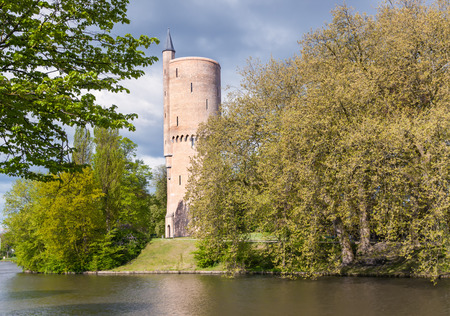 superstructure: tower over the pond in the park of Bruges, Belgium