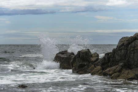 breaking: Waves breaking on the rocks. Stock Photo