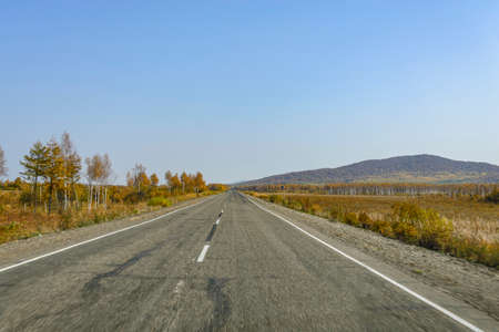 far eastern: Mountain road on the Far Eastern taiga. Mountain road on a ridge of the Sikhote - Alin, Far East Russia.