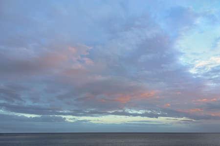restless: Sunset over the sea. Orange sunset over the restless sea. Stock Photo