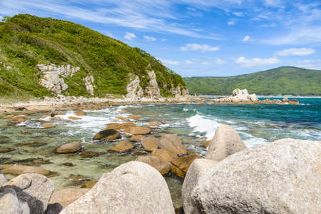 secluded: Turquoise lagoons. Rocky shore, Storm. Secluded beach.