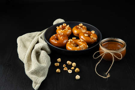 Donuts with caramel and nuts, rustic style, copy spase Stockfoto