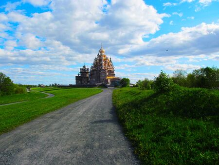 Wooden Church of the Orthodox Church with beautiful clouds. Stock fotó