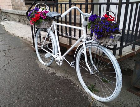 Vintage two-wheeled bike with flowers on it front view. Stock fotó