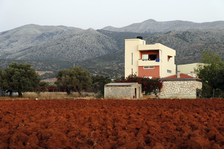 red soil: Plowed field with red soil. Crete, Greece