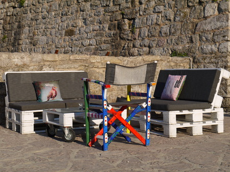 Seats And Table Made Out Of Pallets In stone  wall
