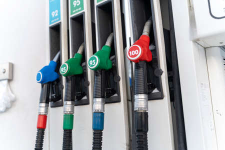 fuel dispensing nozzles at the gas station in