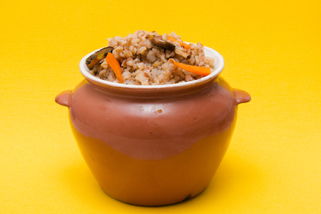 boiled brown buckwheat beans with mushrooms, carrots and onions
