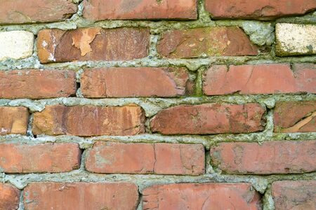 wall with refractory bricks of red color. old building