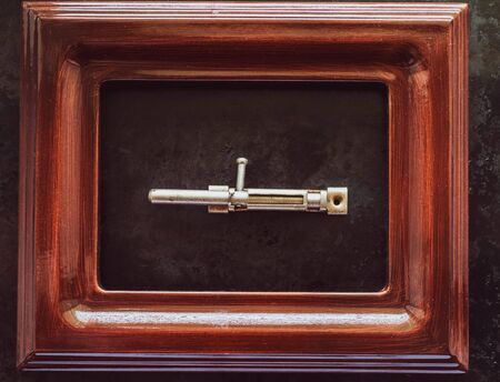 latch located in the picture frame. housing safety concept
