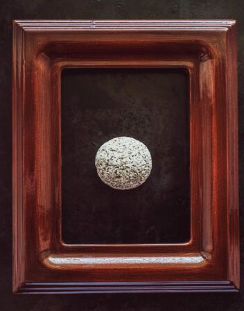 river stone of white color in a frame from a picture. the concept of certainty, stability, inviolability, immutability, fortress. photo of stone in the frame