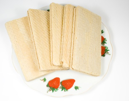 crackling: Crackling wafers with a white cream on a saucer