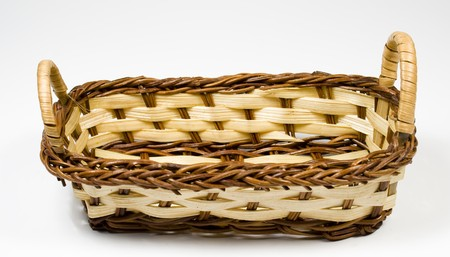 bast basket: Bast basket from wooden strips of yellow and brown colour