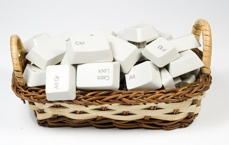 bast basket: Bast basket with destroyed keyboard buttons on white