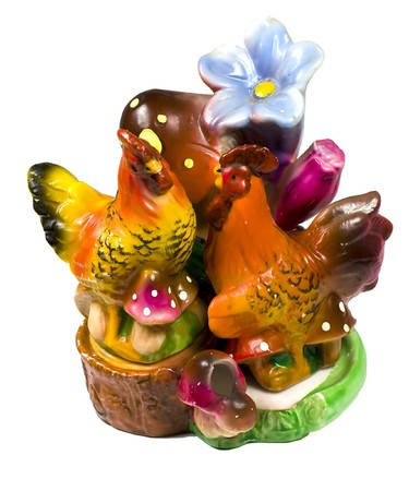 pepperbox: Saltcellar and peperbox in the form of a cock and hen on flower Stock Photo